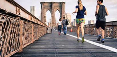 People Running on Bridge